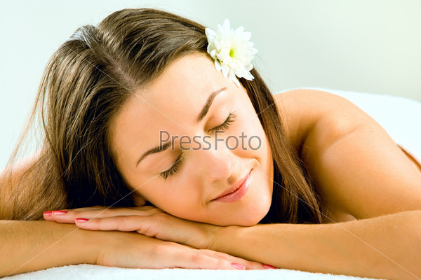 Image of beautiful head putting on her hands and sleeping