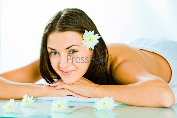 Portrait of happy attractive woman resting in the salon