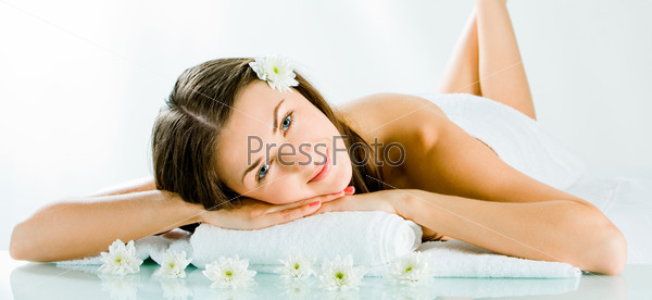 Portrait of cheerful woman resting and looking at camera