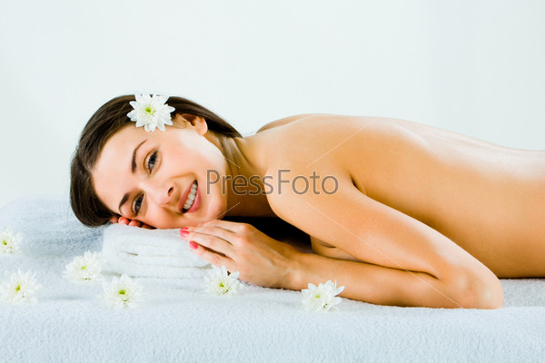 Pretty young woman lying on the towel