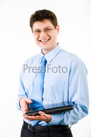 Image of smiling businessman holding the laptop on a white background