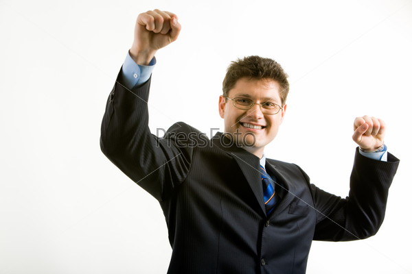 Portrait of happy businessman in suit raising his hands