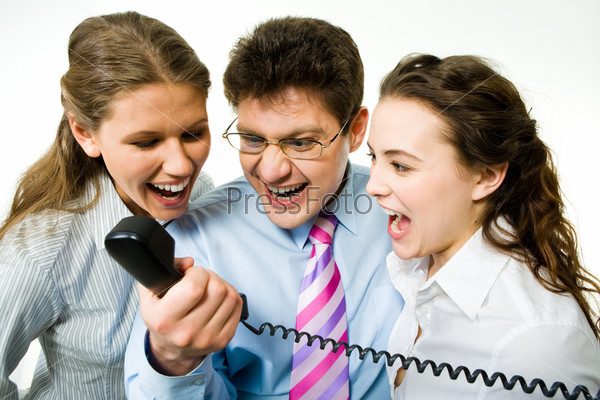 Portrait of three business people screaming on the telephone