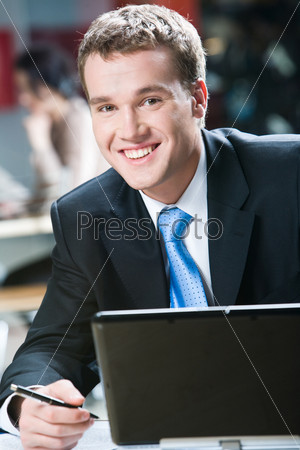 Image of handsome specialist with smile in the cafe