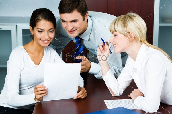 Image of business conversation of three confident people