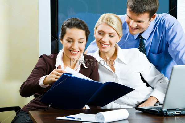 Group of three business people working together in the office