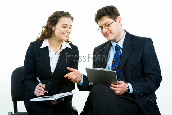 Photo of successful business people looking at laptop screen at meeting