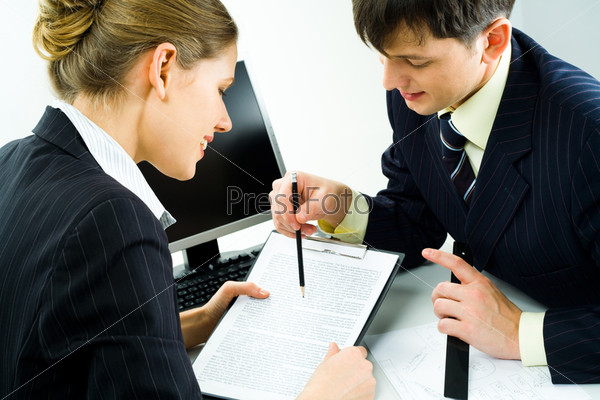 up of two confident colleagues looking at document attentively