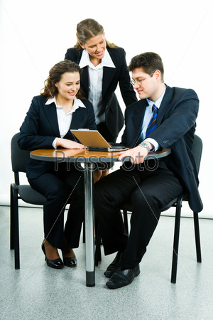 Portrait of successful business group interacting at working meeting