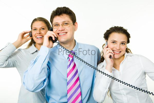 Group of smiling consultants speaking on their phones on white background