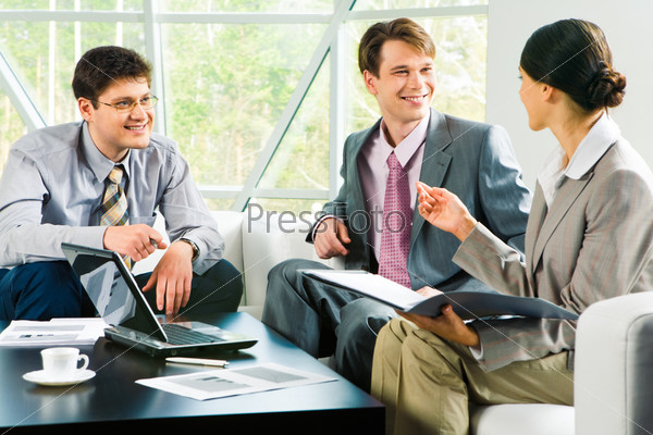 Image of successful business team discussing a new project at meeting