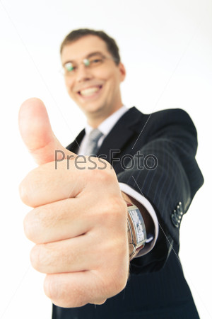 up of thumb up on the background of happy businessman looking at camera
