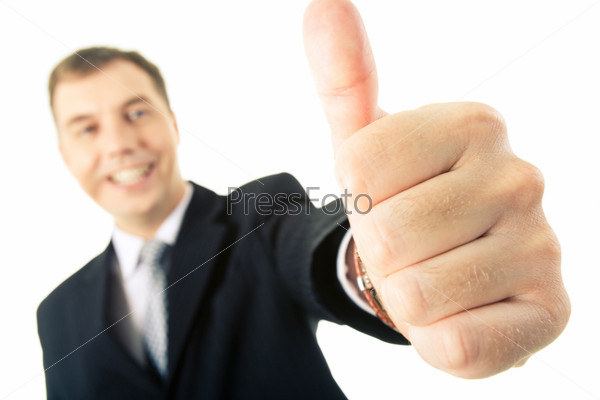 Businessman showing thumb up as a sign of successful deal