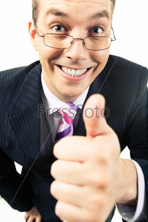 up of happy businessman showing thumb up and looking at camera with smile