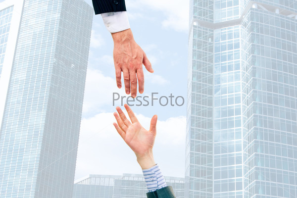 Image of two businesspeople giving hands each other