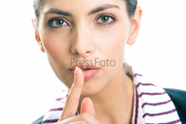Portrait of young business woman with the finger near her lips