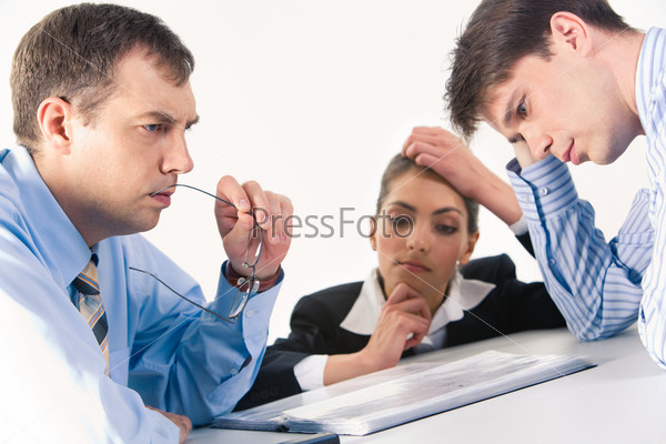 Image of three professionals thinking about business-plan