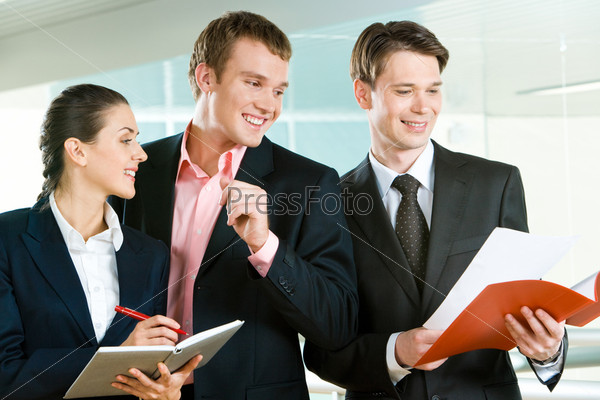 Photo of group of colleagues looking at business plan
