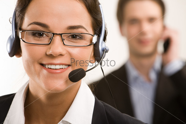 Portrait of responsible operator on the background of businessman