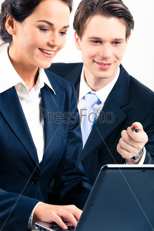 Portrait of businesswoman and businessman working together