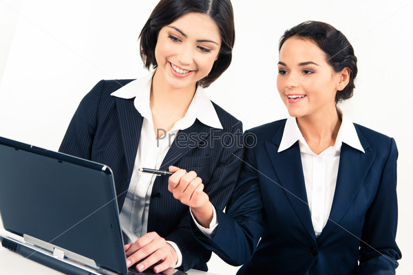 Portrait of two partners sitting at the table and doing a computer work