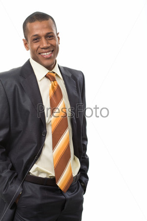 Привлекательный успешный бизнесмен в деловом костюме