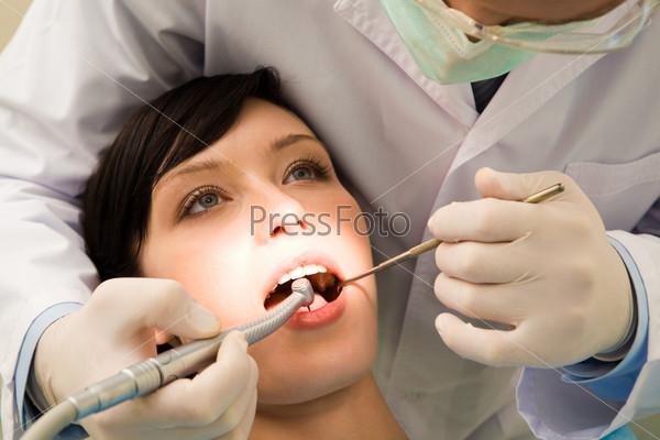 Examining oral cavity