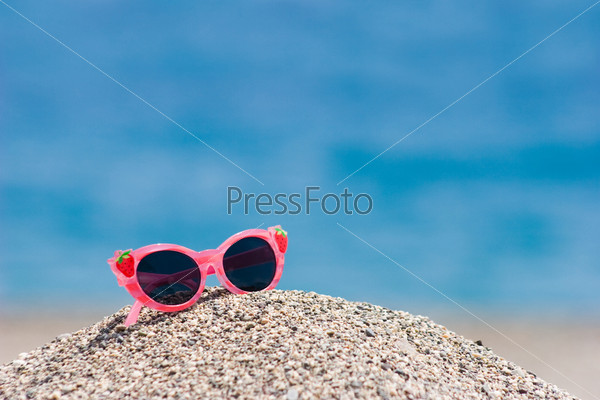 Sunglasses on pebbles