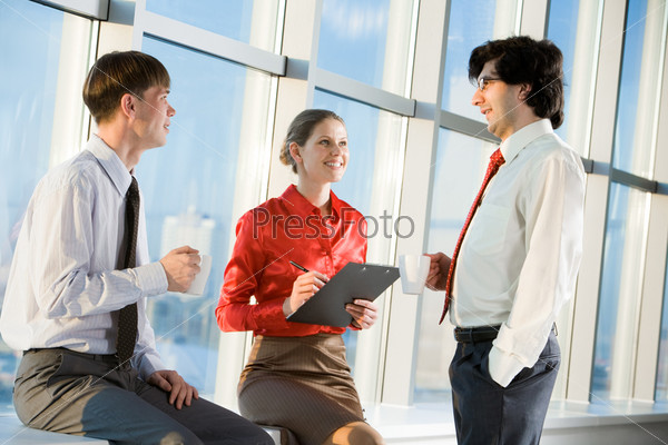 Portrait of three business people discussing new project at meeting