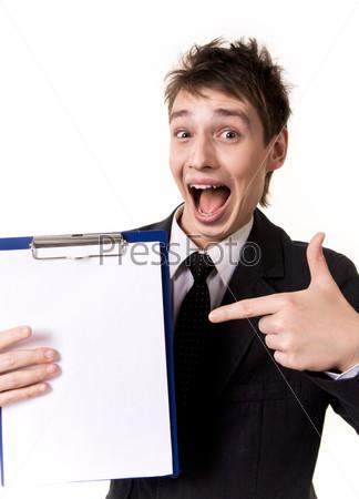 Фотография на тему Удивленный бизнесмен указывает на бланк в его руке