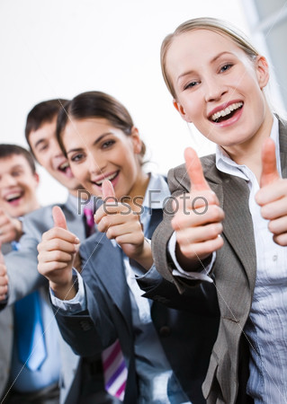 Vertical image of business people giving the thumbs-up sign