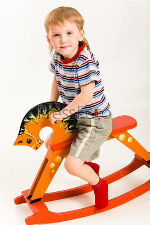 Boy on toy horse