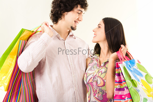 Young couple with bags