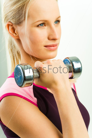 Girl holds barbell