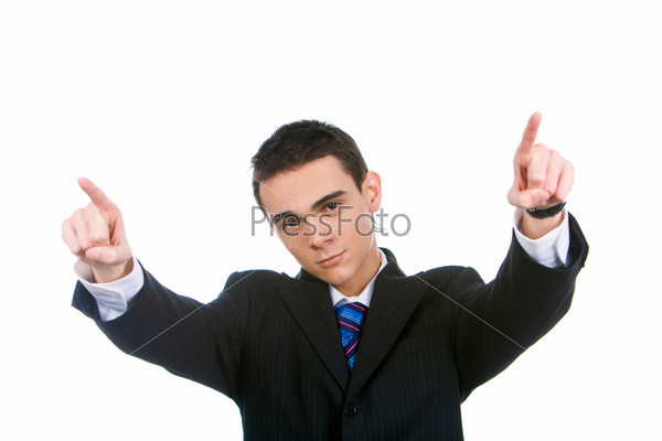 Portrait of successful guy pointing at camera with forefingers stretched forwards