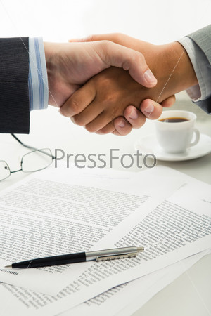 Handshake over workplace