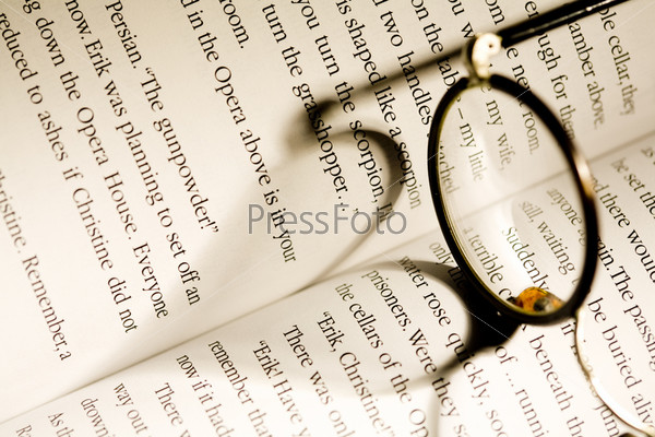 Image of glasses lying on a book