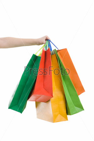 Фотография на тему Разноцветные пакеты в женской руке на белом фоне