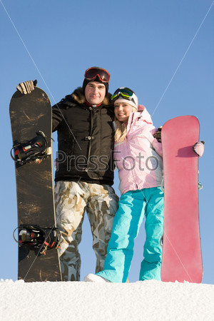 Happy snowboarders