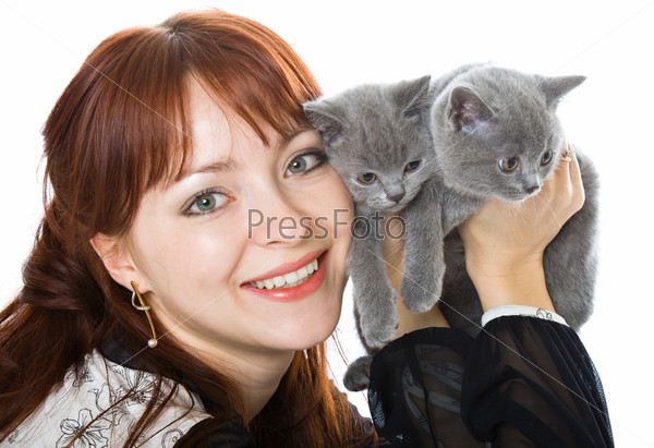 The young girl and two kittens