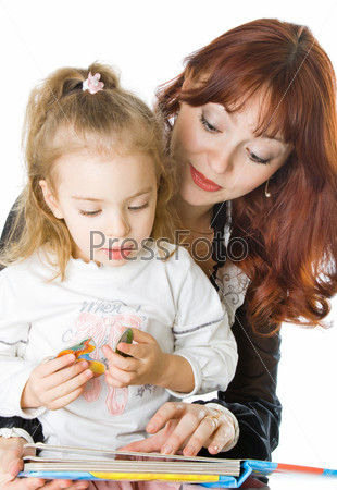 A mother and a daughter reading a book