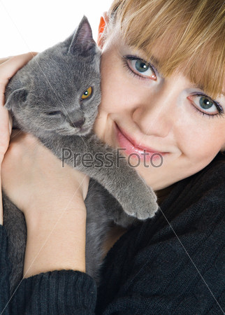 The young girl and  kitten