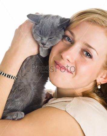 Young beautiful woman and kitten