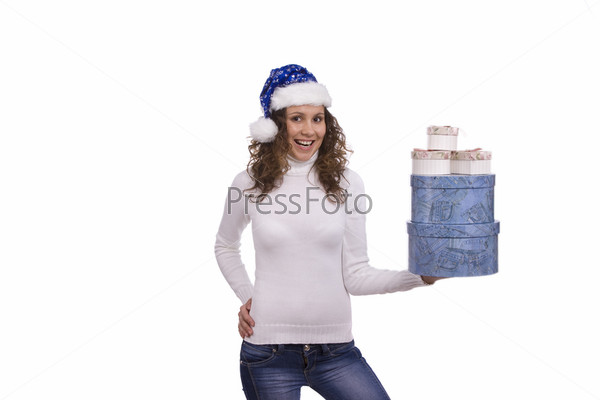Woman dressing up in blue Christmas cap holding gift