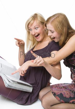 Two girls reading magazine