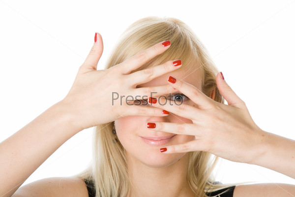 Portrait of a beautiful woman looking through fingers
