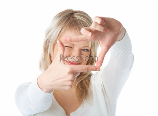 Young blonde woman looking through a frame made by her fingers