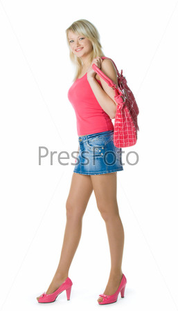 Blond young woman in red with red bag