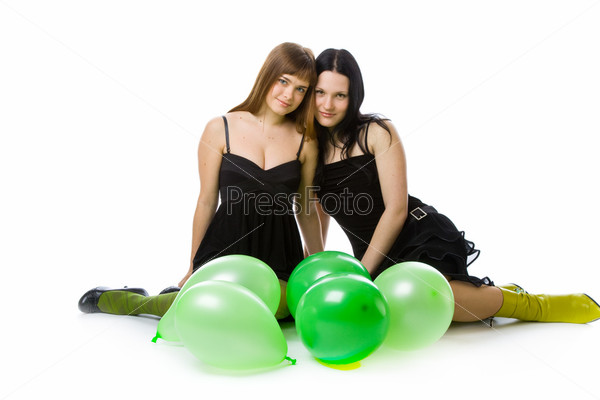 Two young girls with green ballons