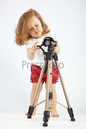 Little girl with tripod
